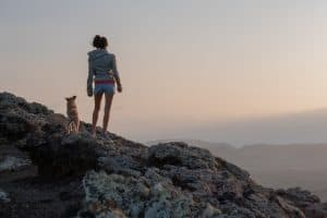 Girl at the Mountain Top with Dog